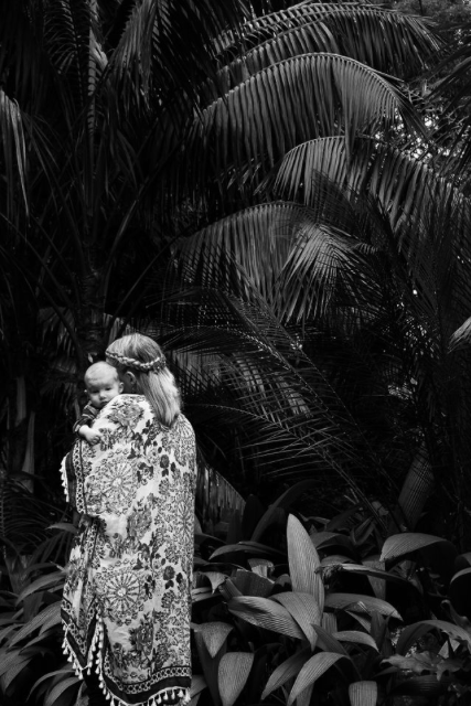 new mother holding baby palm tree black and white