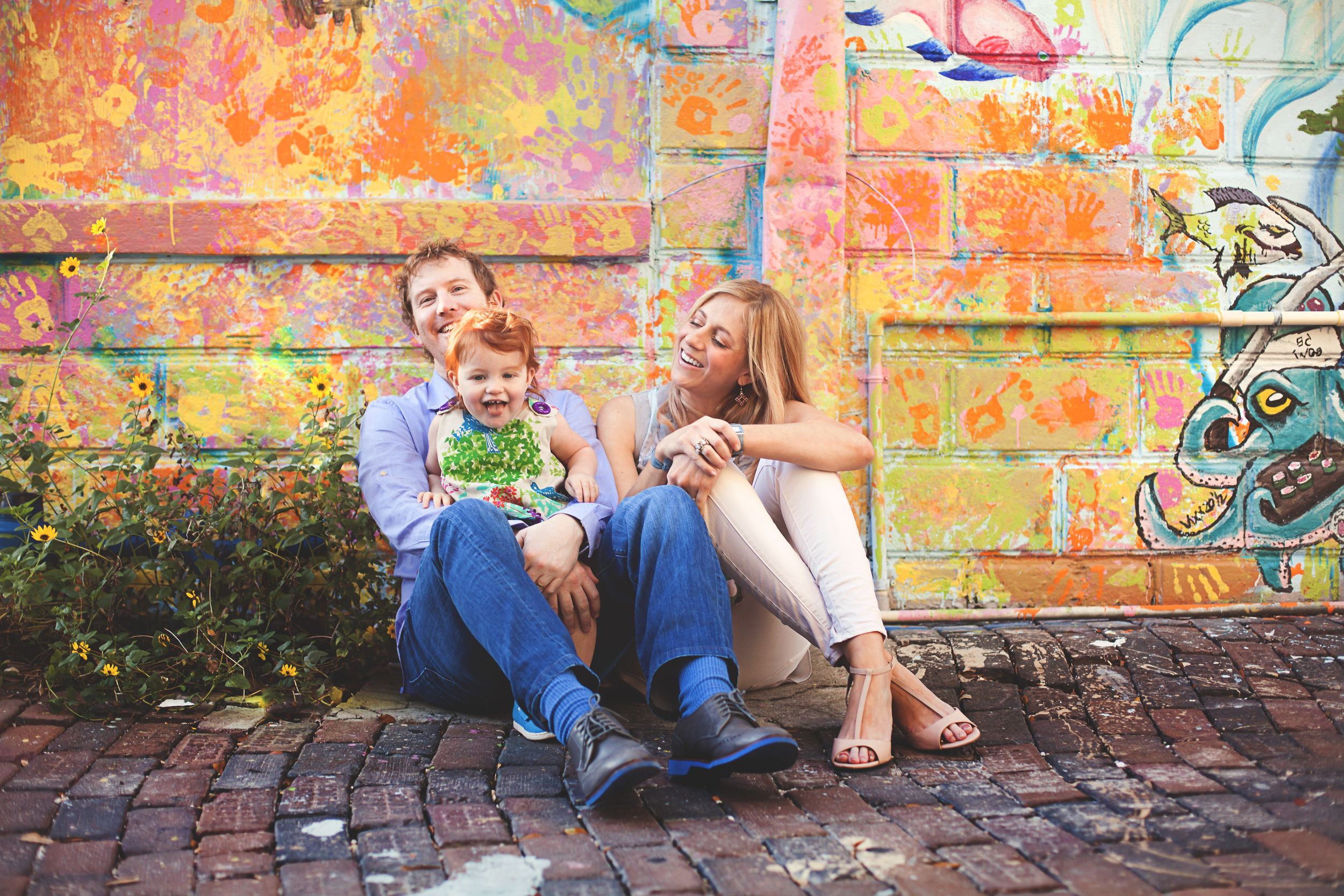 St. Pete family photos in front of colorful mural