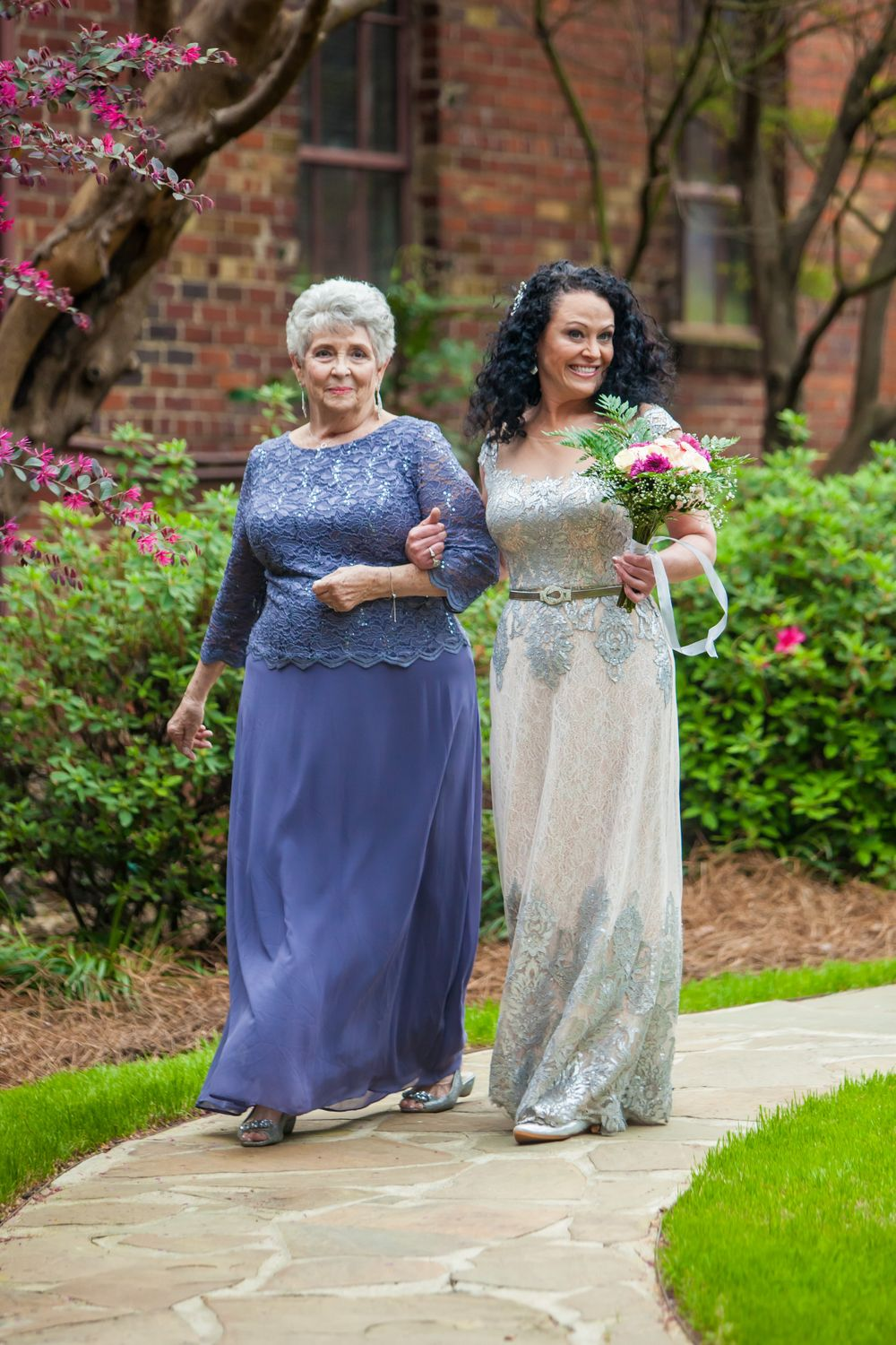 Bride is walked down the aisle by her mother during a wedding ceremony at Senate's End in Columbia, sC