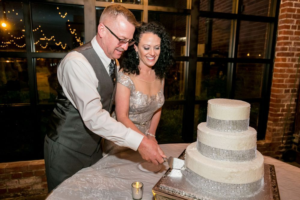 Bride and groom cut the cake during their reception at Senate's End in Columbia, SC