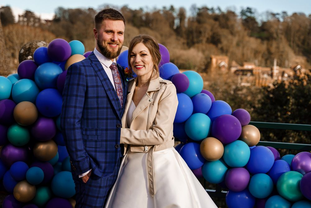 Colourful peacock wedding theme with balloon arch.
