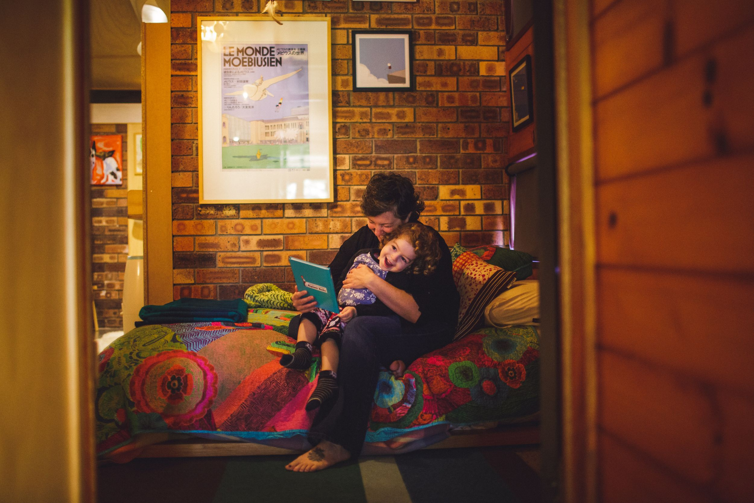 Mum and child hugging in Brisbane home