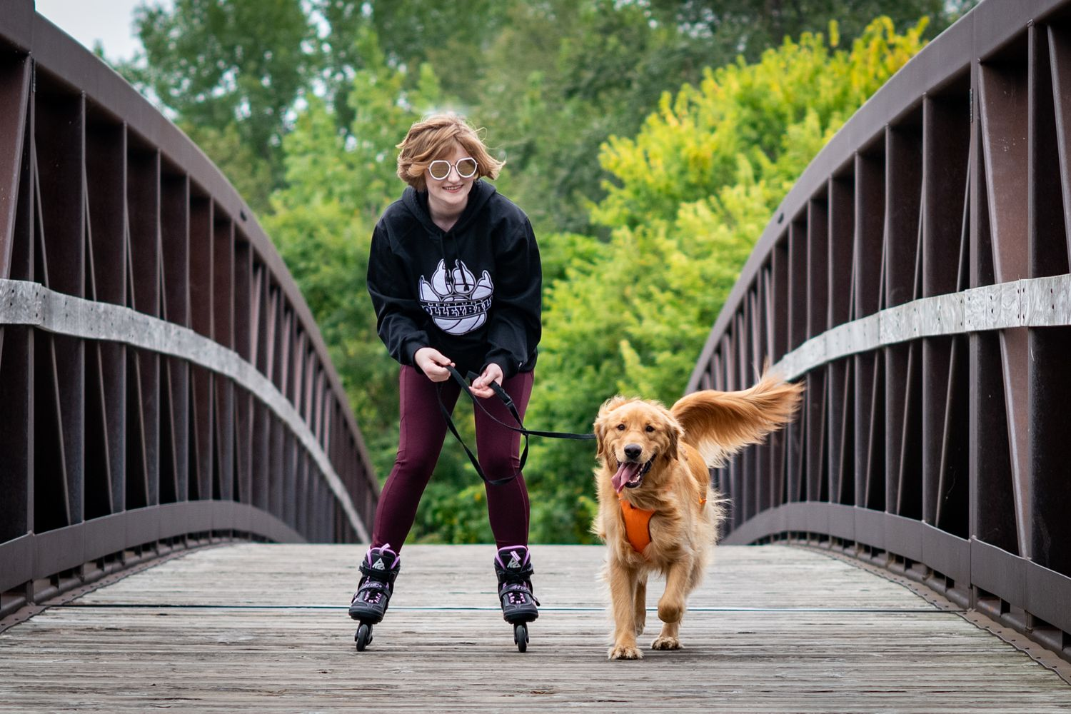 Senior Photo Rollerbladding with Golden Retriever