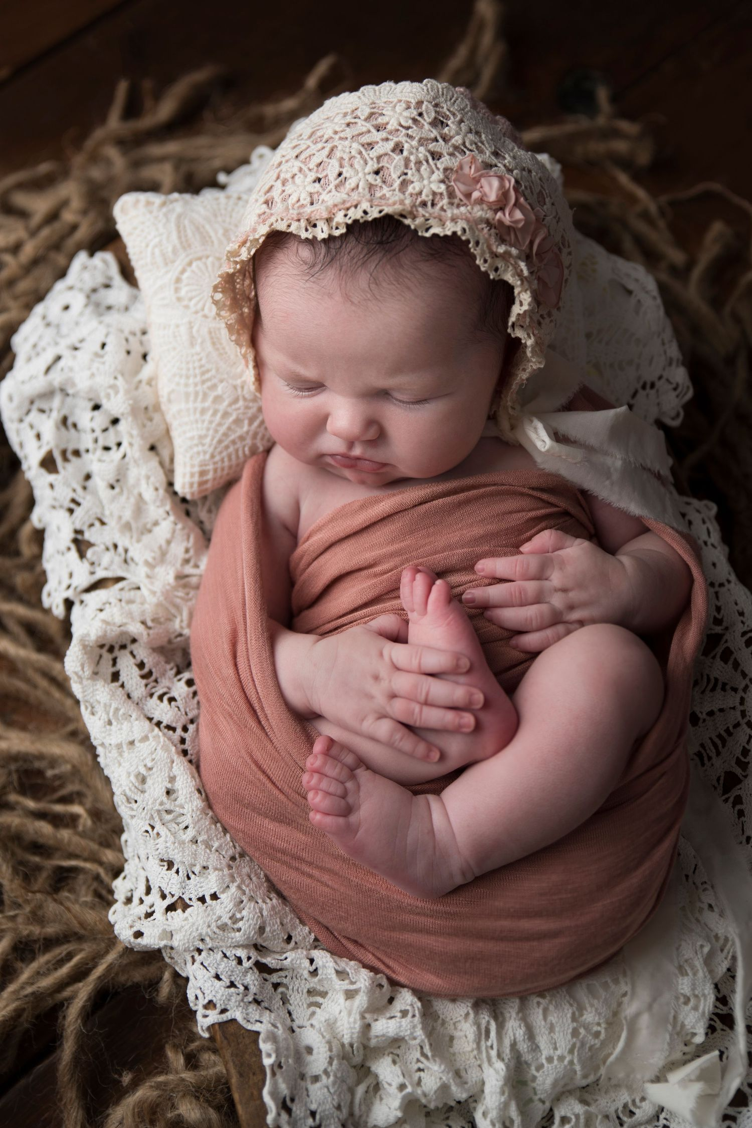 baby girl with bonnet on lace