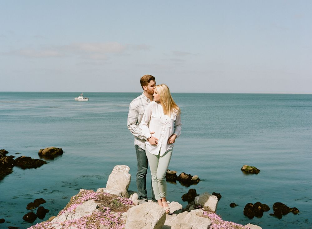 Carmel California wedding engagement photographer Aaron Snow Photography Lovers Point Monterey couple on rocks