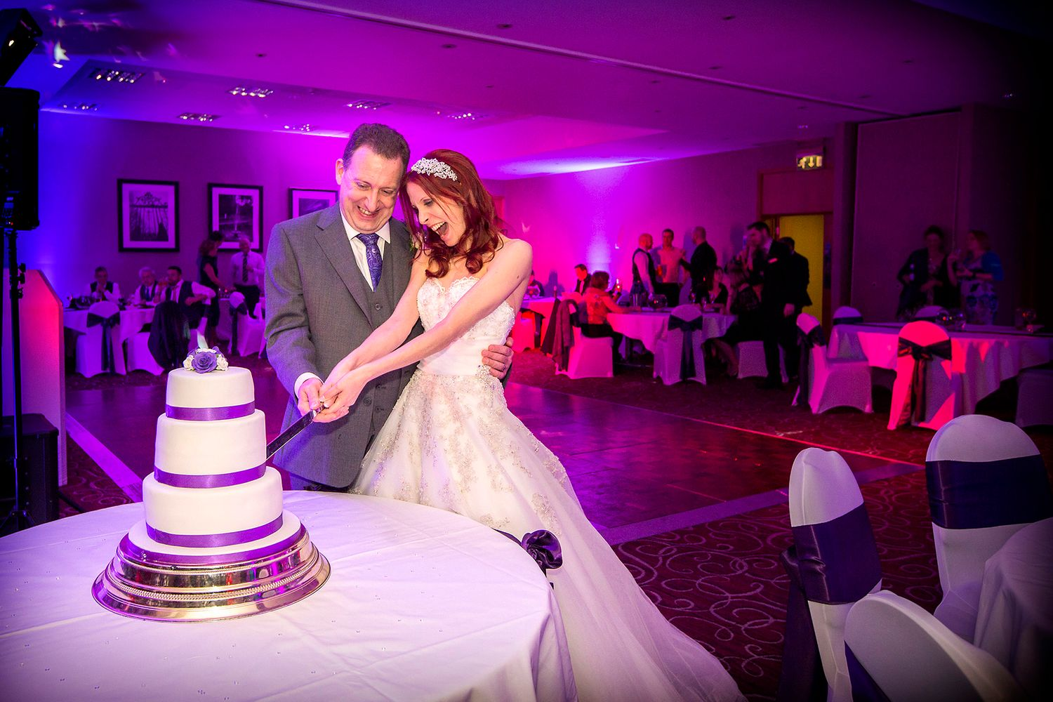 bride and groom cutting cake at eastwood hall wedding photography