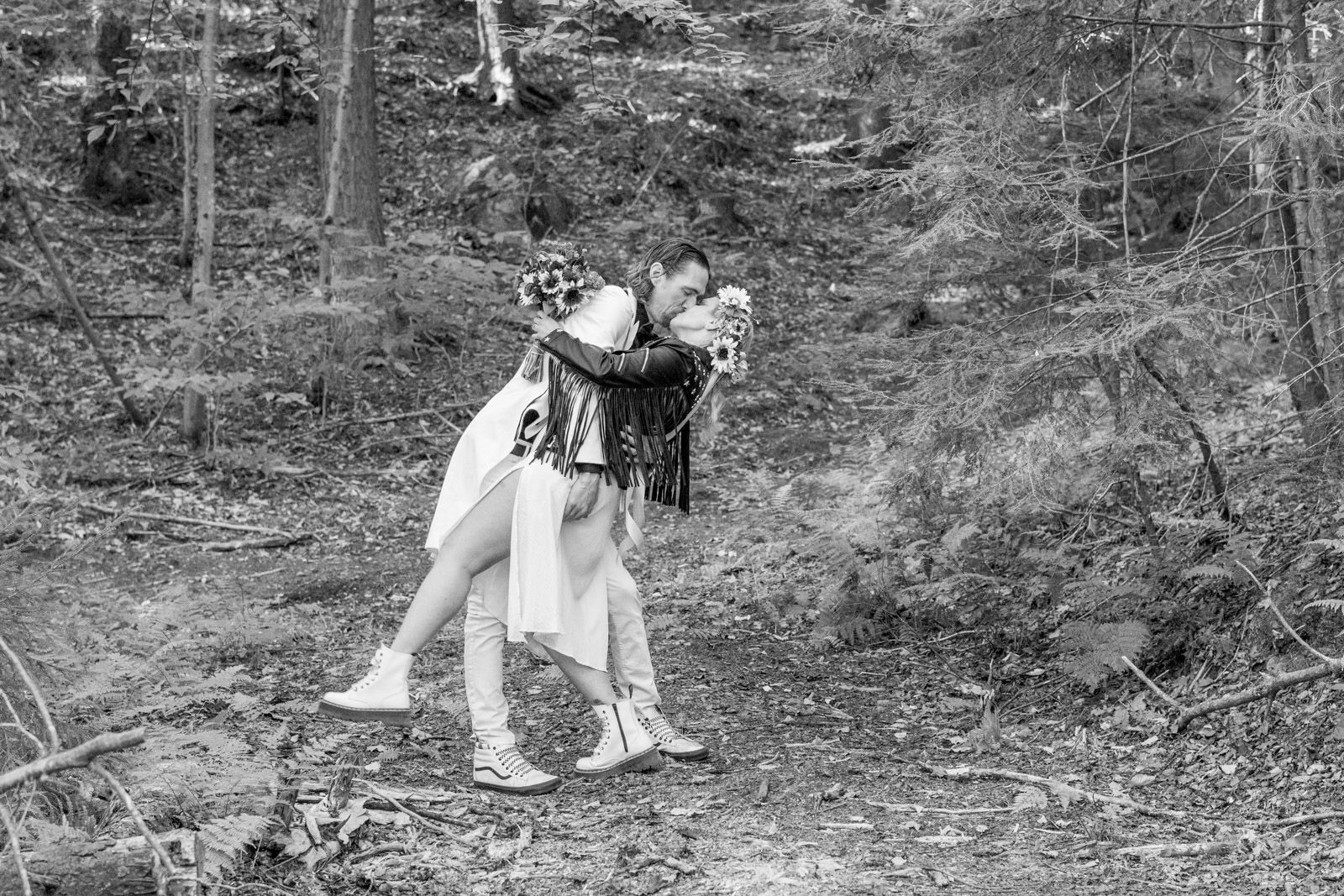 Bride and Groom kissing in Vermont forest