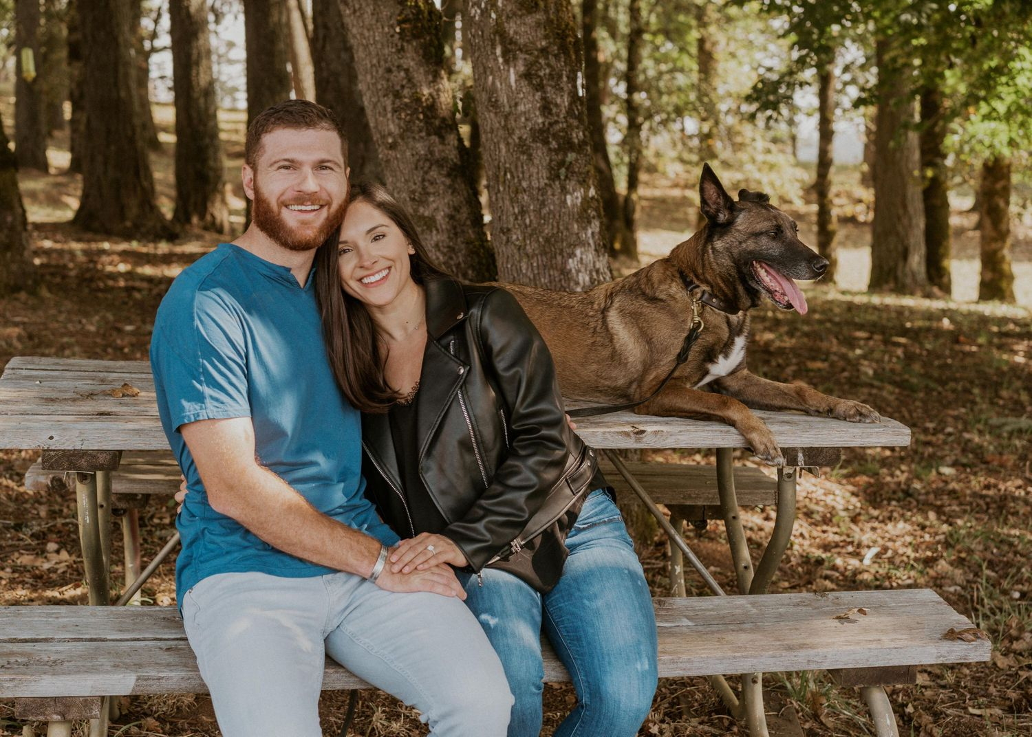 Portrait of the newly engaged couple with their military service dog