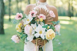 Lost Hill Lakes Events Photography of bride holding spring flowers by St. Louis Wedding Photographer JKG Photography