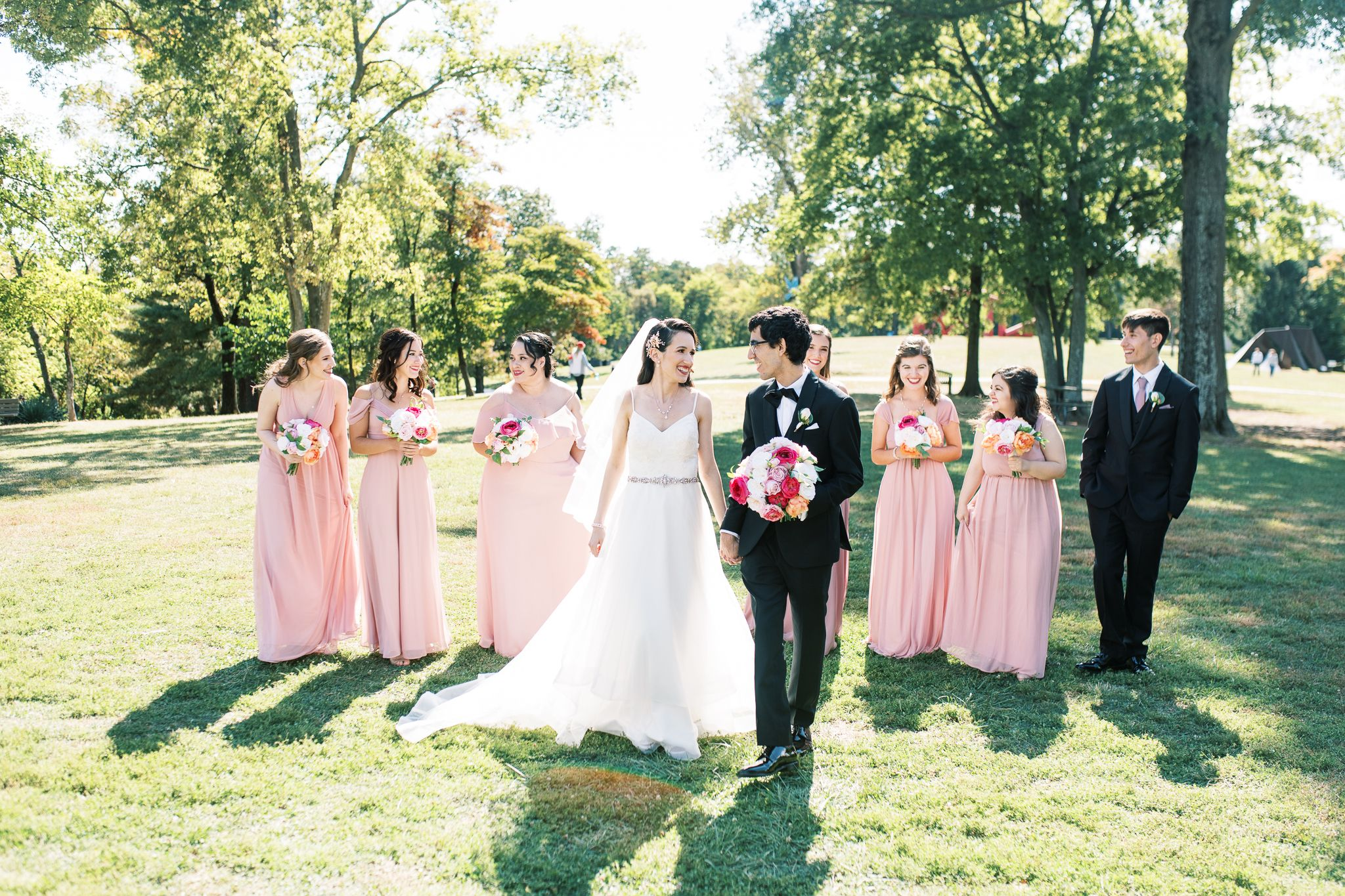 Laumeier Sculpture Park Photography of bridal party walking taken by St Louis Wedding Photographer JKG Photography