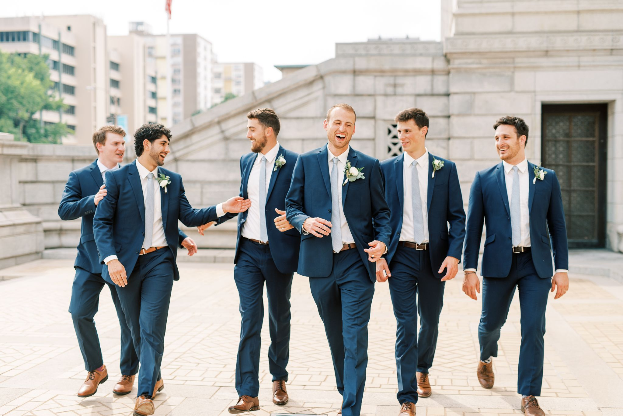 St. Louis Public Library Photography of groomsmen in navy blue tux by St Louis Wedding Photographer JKG Photography