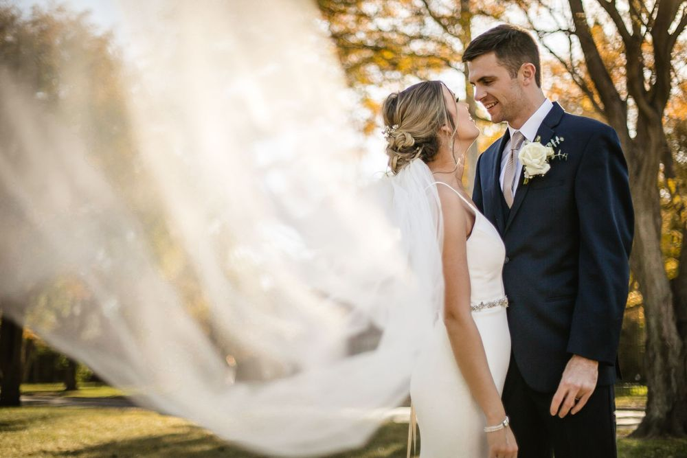 Garden City Kansas bride groom veil fall outdoor