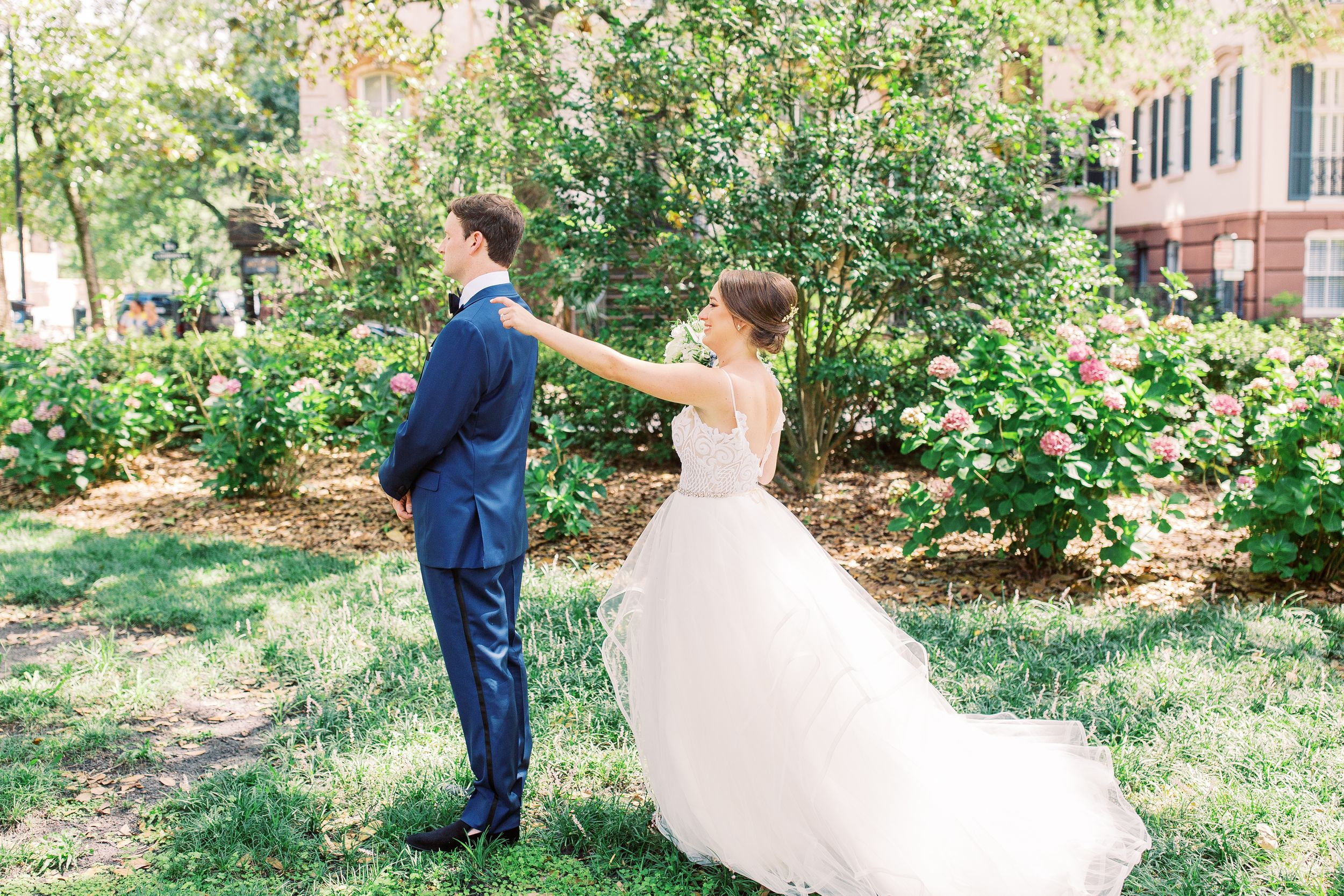 bride and groom in monterey square doing first look in downtown savannah, ga