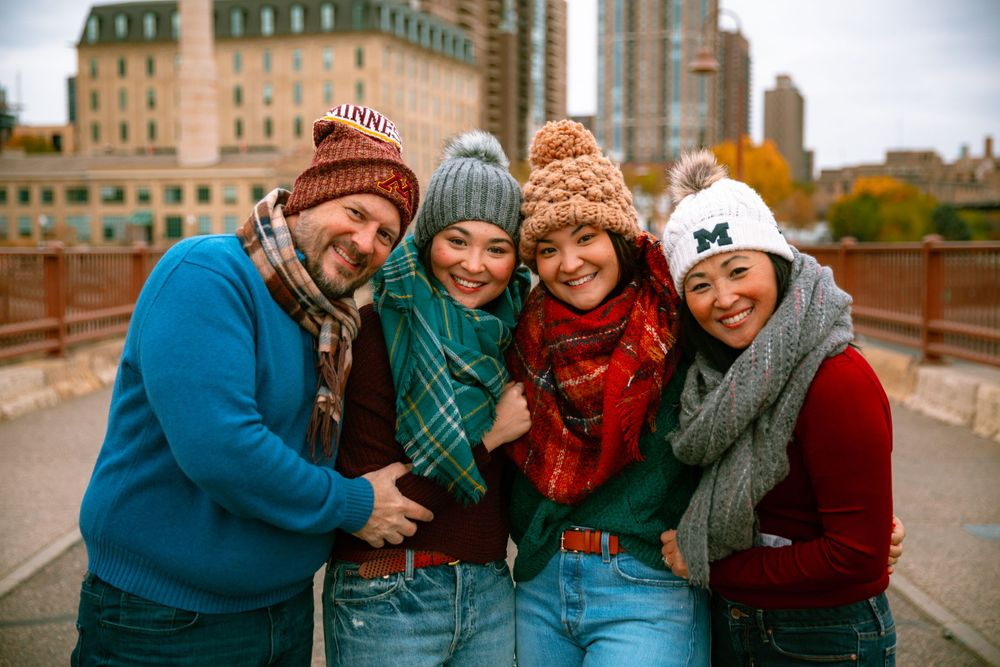 family of four bundled up for cold weather with skyline backdrop