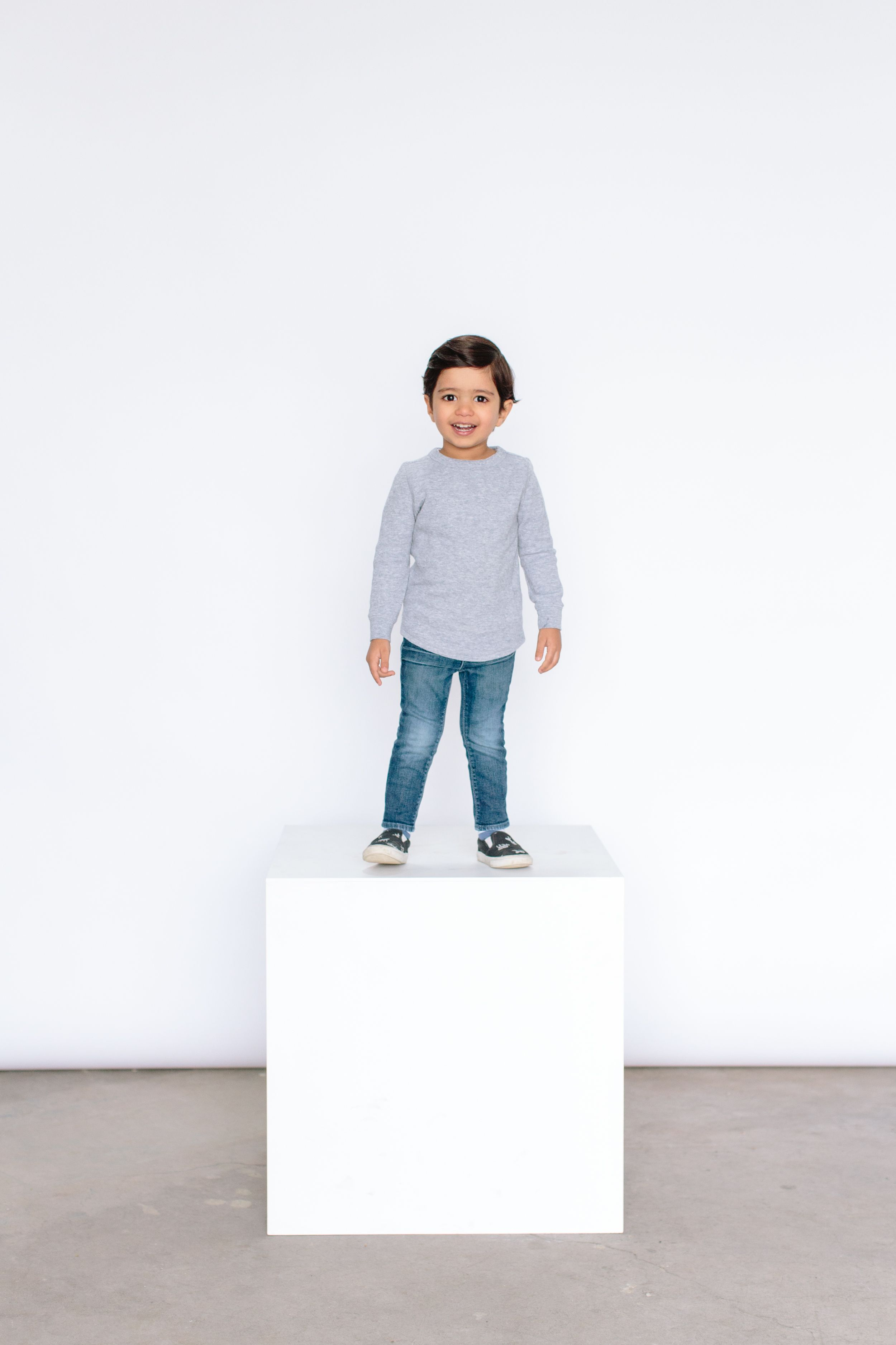 boy standing on white box