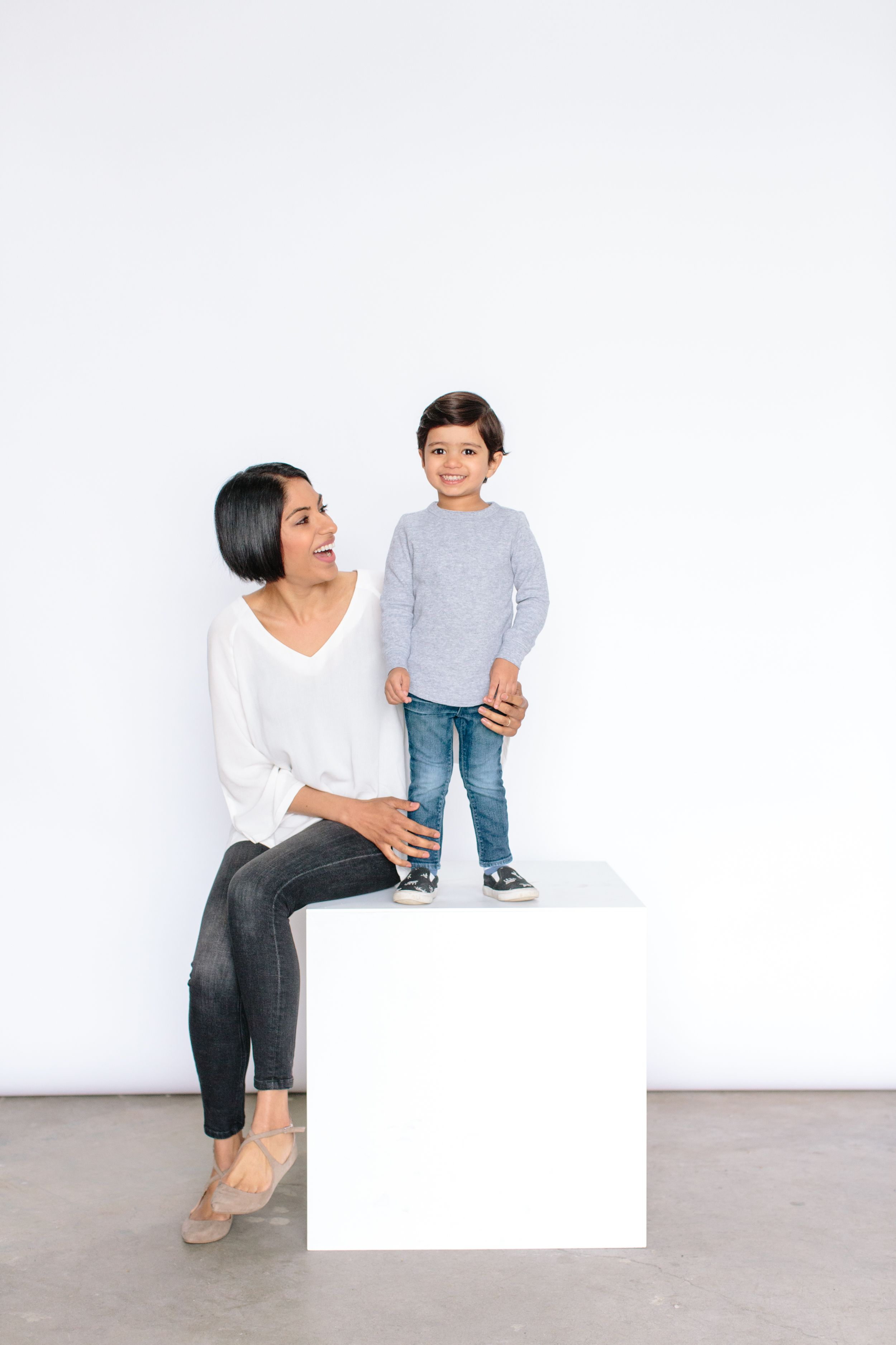 mom and son on white box