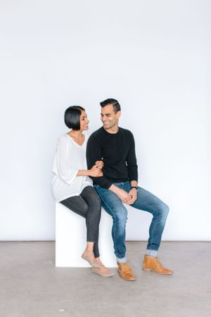 couple sitting on a white box