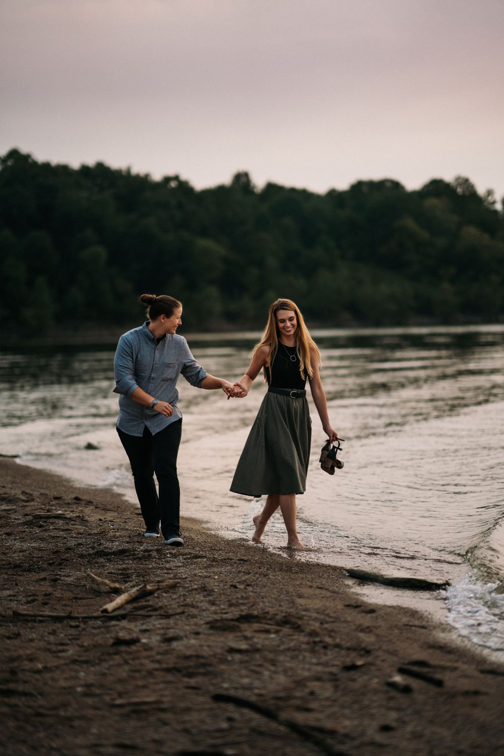 Cincinnati, Ohio photography of lbgtq+ couple at lake with their pet dogs.  Dayton photography