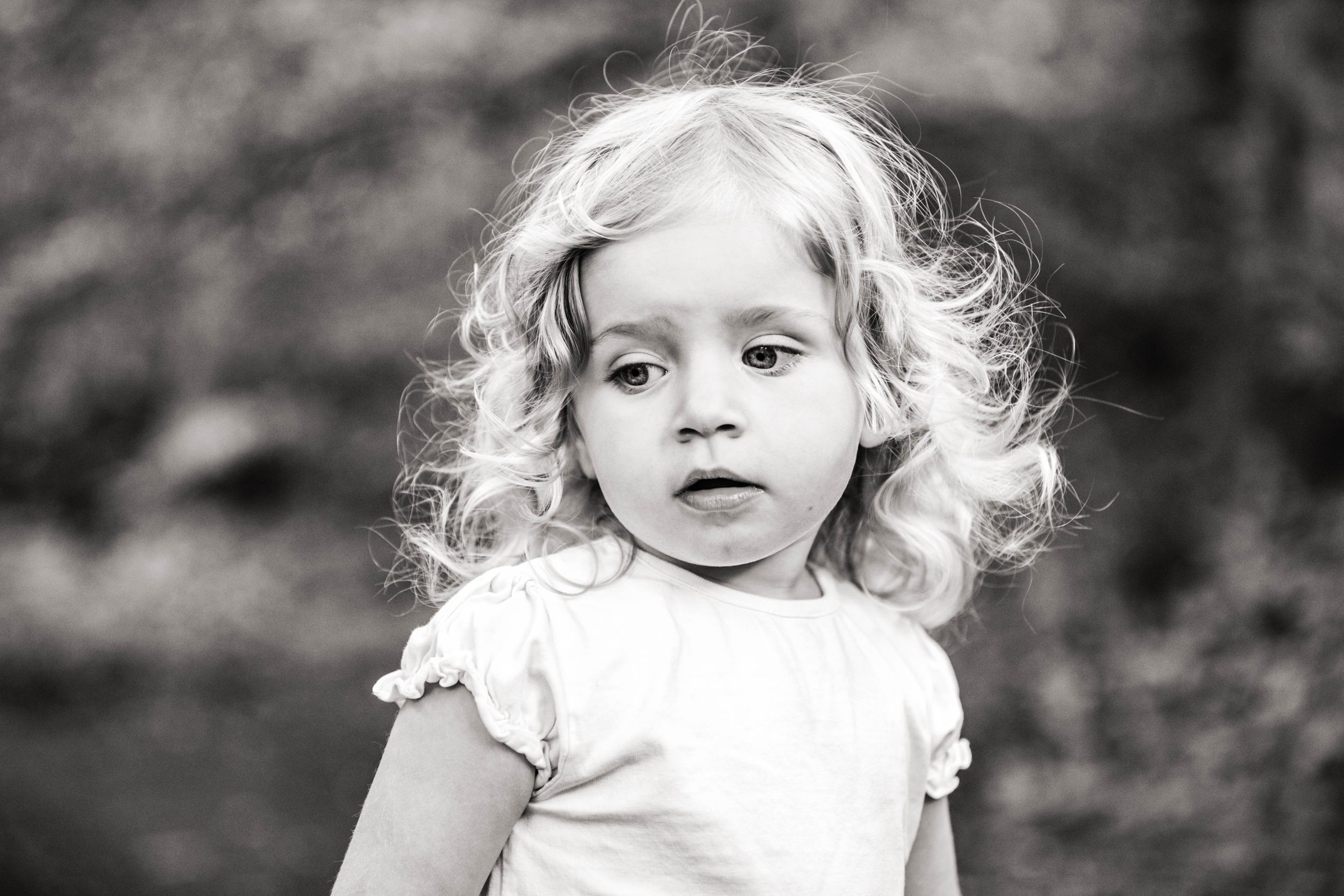 black and white portrait of little blonde haired toddler girl