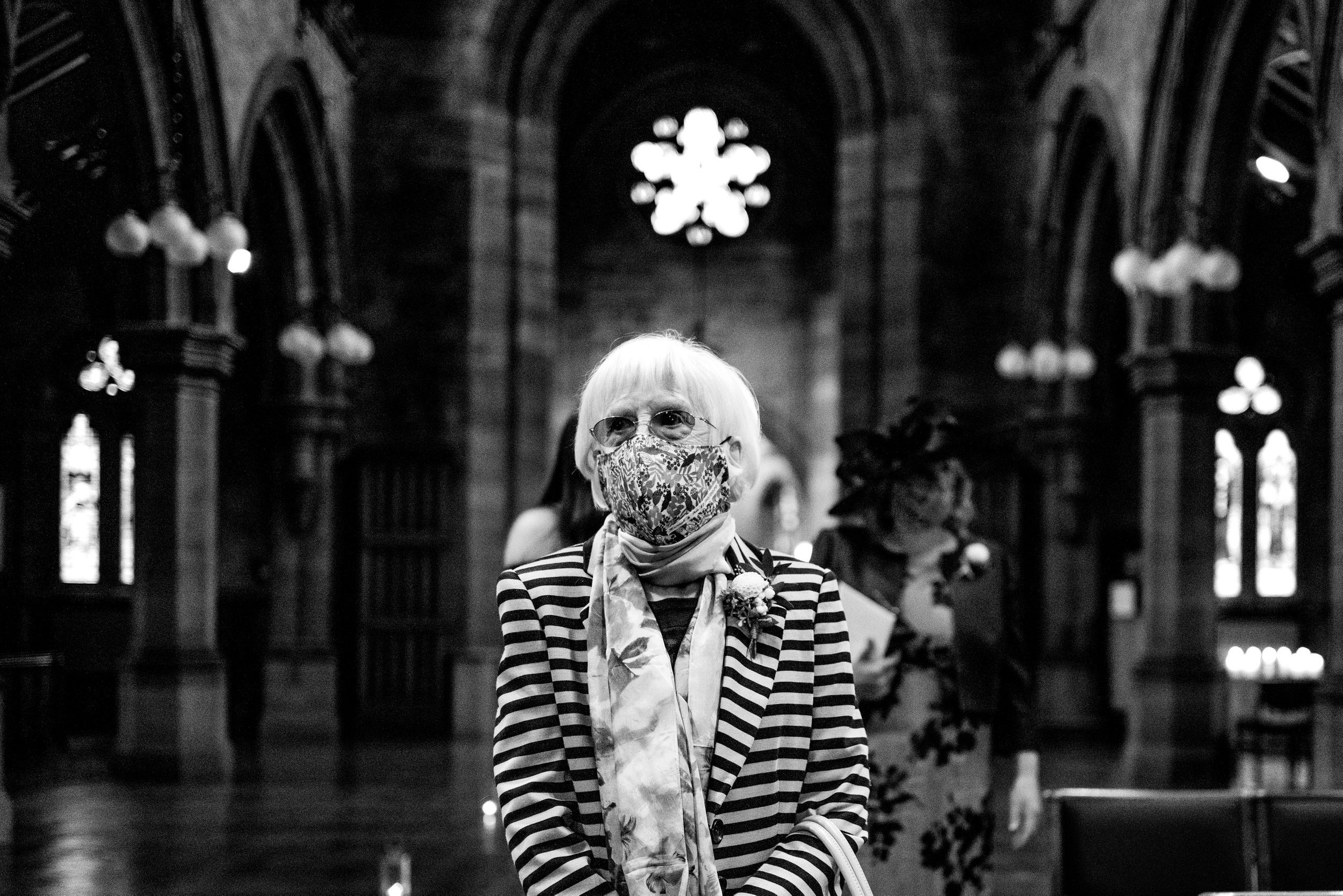 Grandma in covid mask during wedding in chester