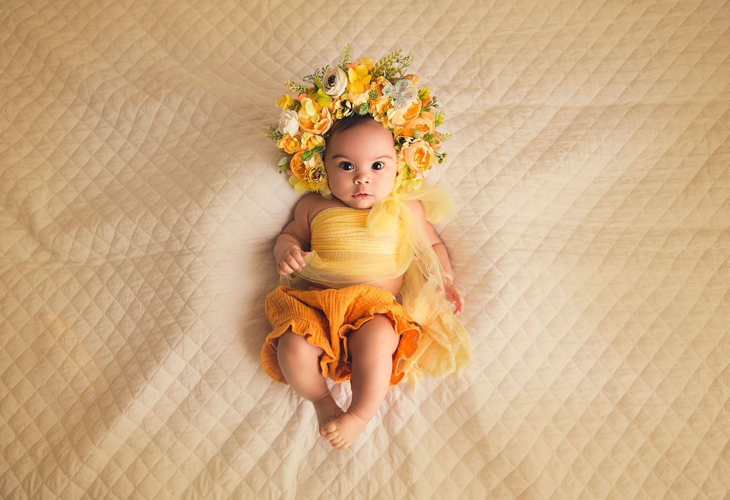 baby girl in yellow with floral bonnet