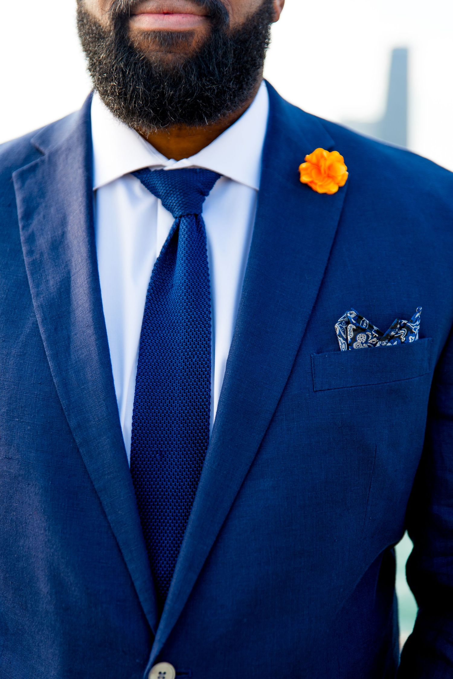 man in navy suit with orange flower boutonniere for Chicago sunrise elopement