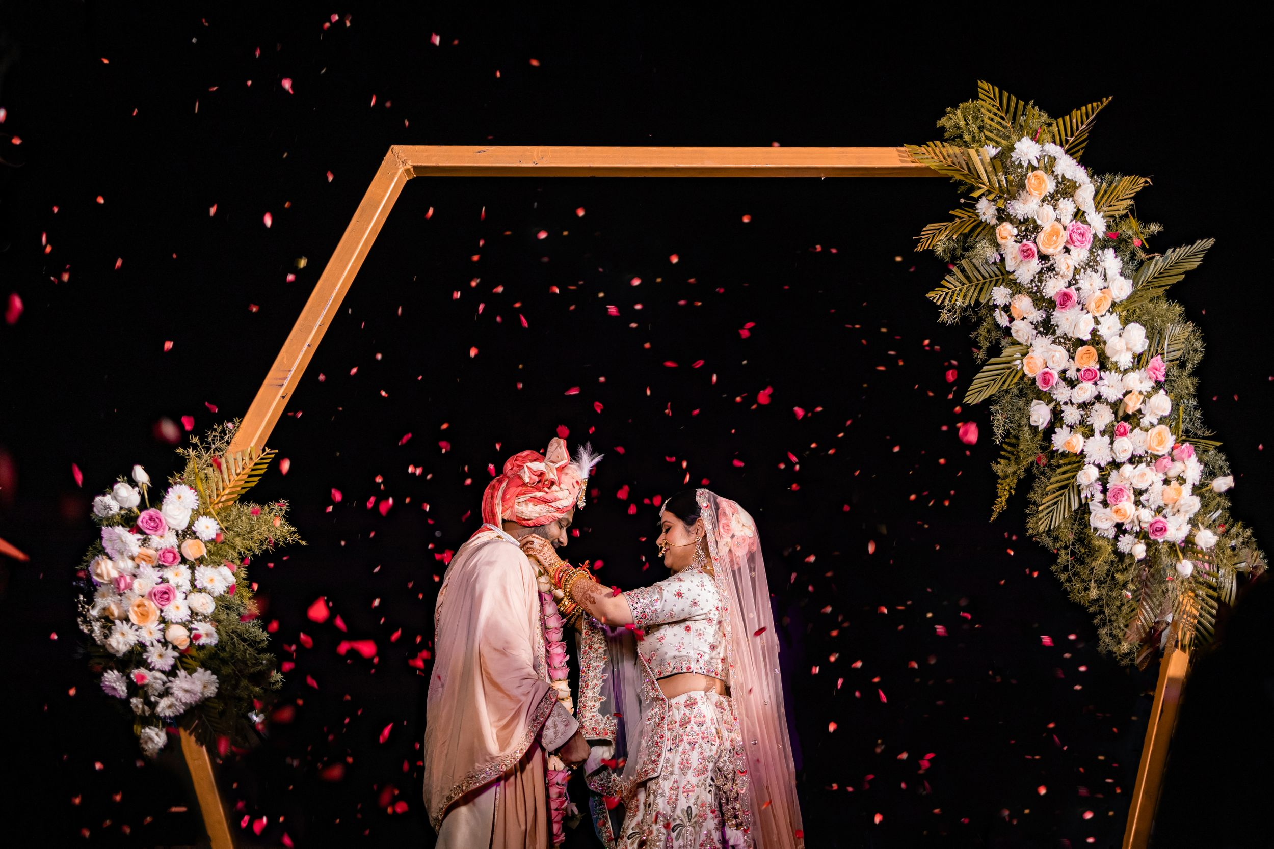 rose petal shower on couple during varmala rituals at destination wedding w-Goa