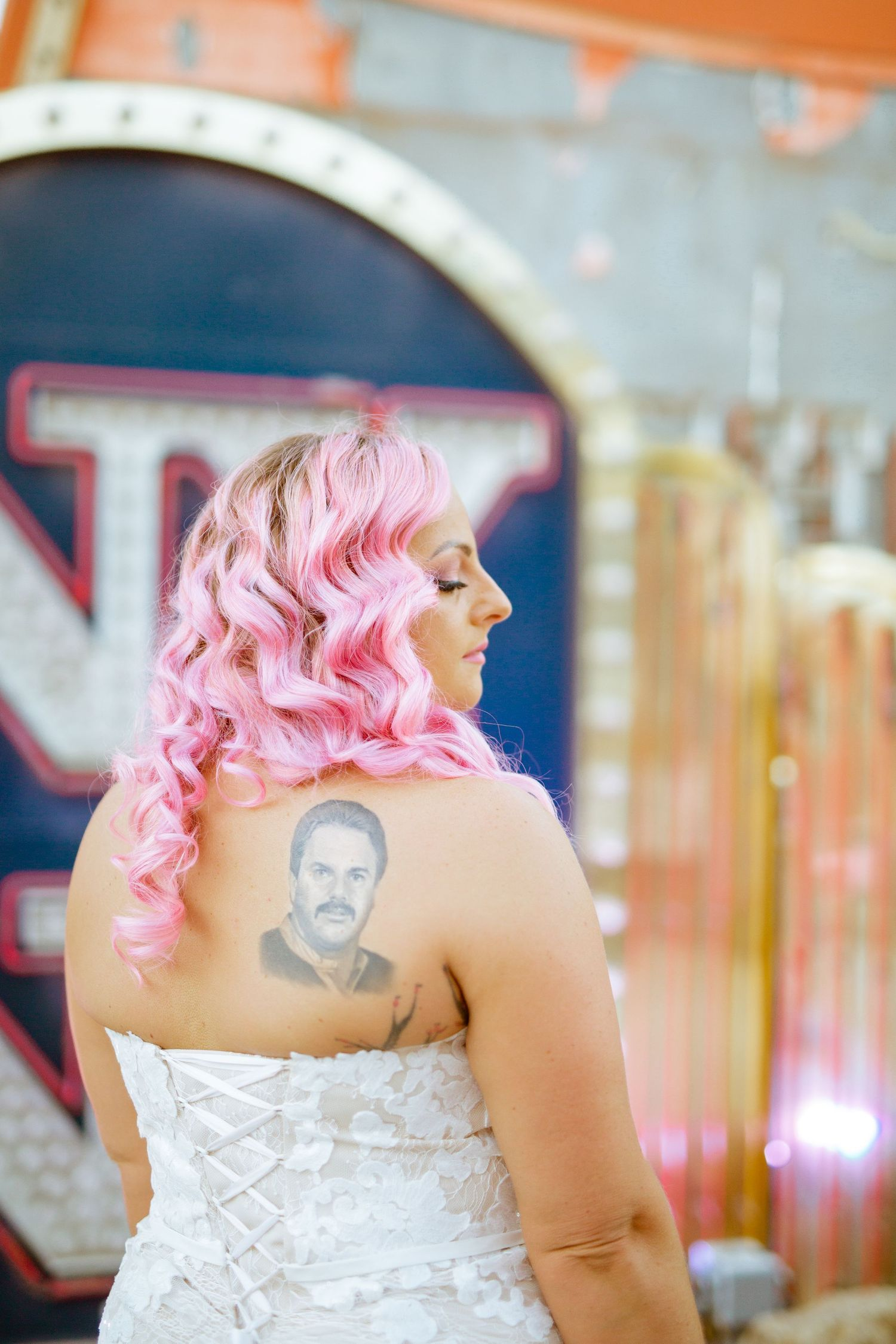 her dads tattoo in front of neon sign at the neon museum
