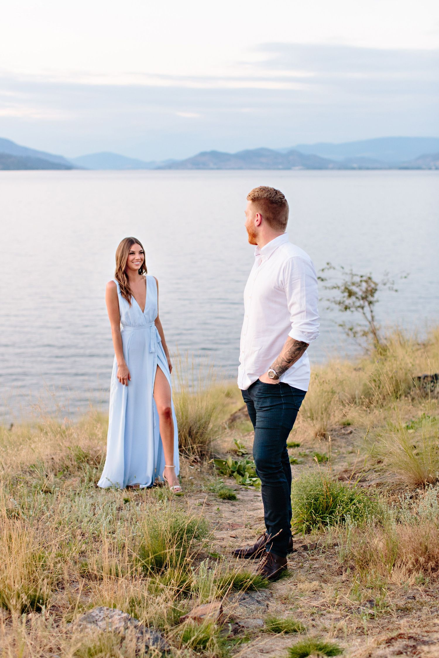 couple looking at each other with lake view