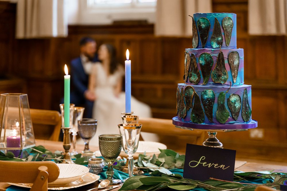 Peacock wedding theme - peacock blue wedding cake on a colourful peacock theme styled table - Winchester wedding