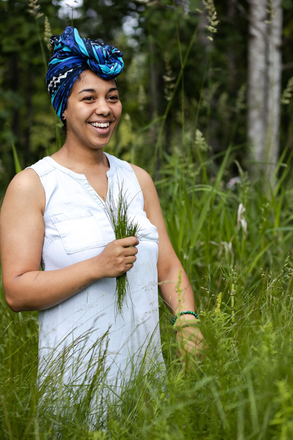 PNW Apothecary black woman owned small business in Federal Way harvesting to make product smiling