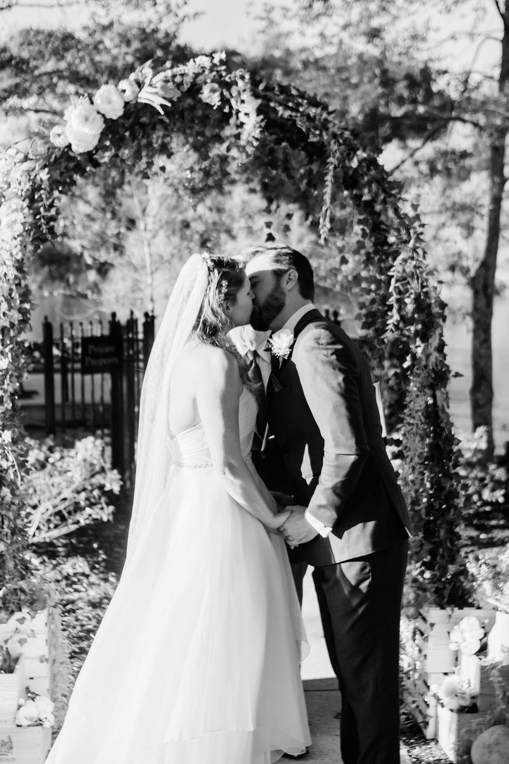 Bride and Groom first kiss as married couple wedding ceremony  Melissa and Chad Sandy Springs Wedding