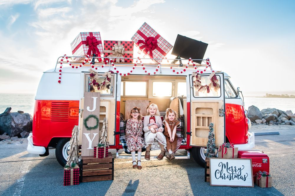 Image of a family with a VW bus decorated for Christmas in Orange County, CA