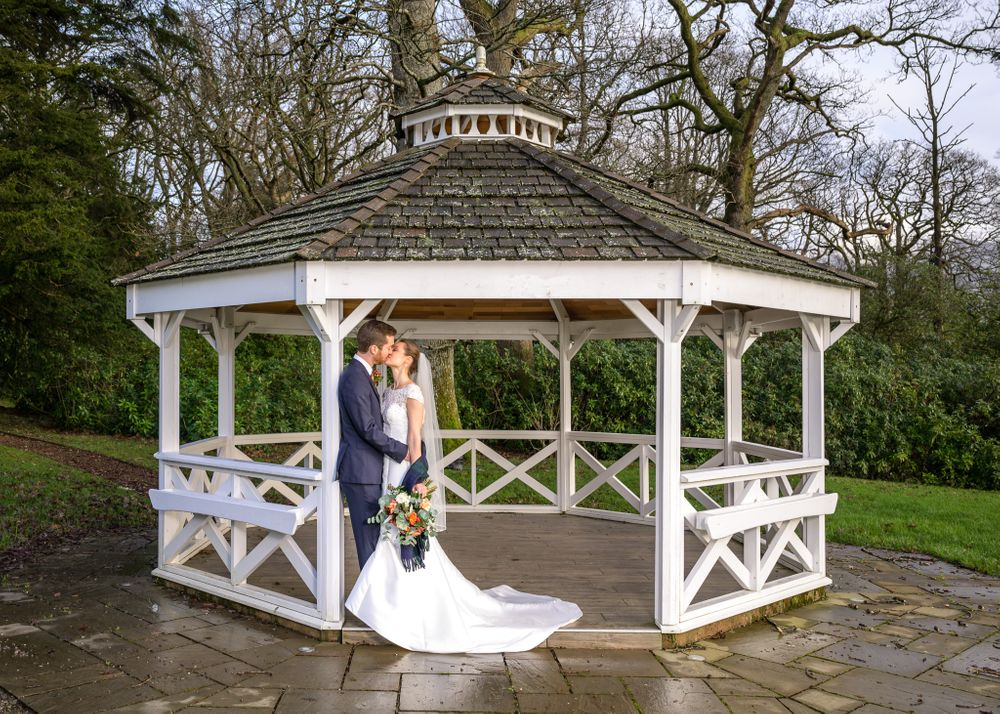 Bride and groom in gazebo at Armathwaite Hall