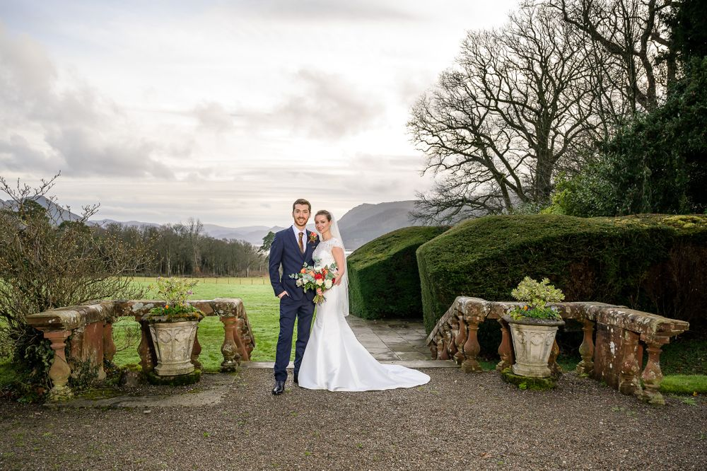 Bride and groom at top of steps down to gardens at Armathwaite Hall