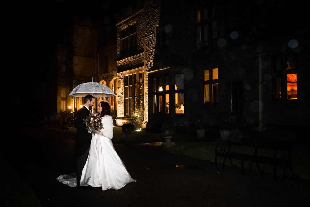 Bride and groom outside Armathwaite Hall at night