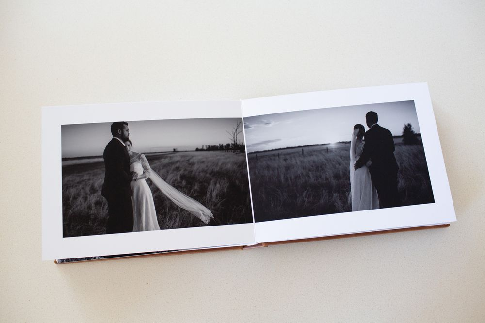 Wedding album pages of black and white photos