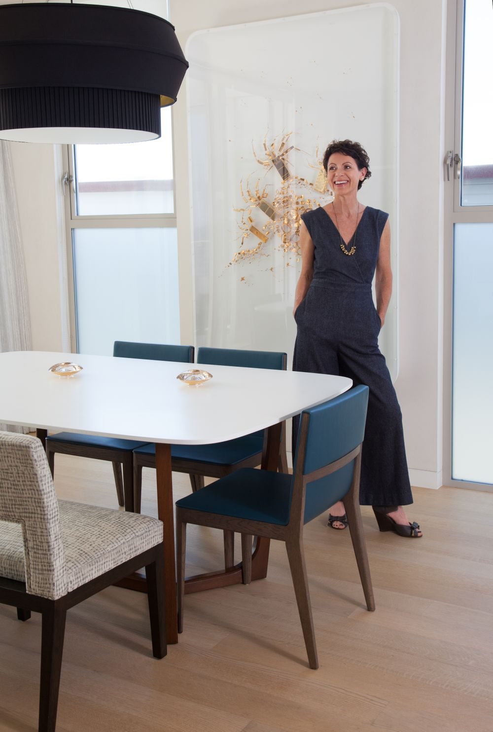 Woman Interior Designer smiling in designer dining room