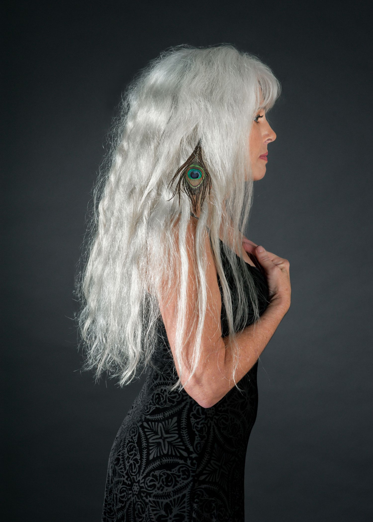 beautiful long silver hair with peacock feather