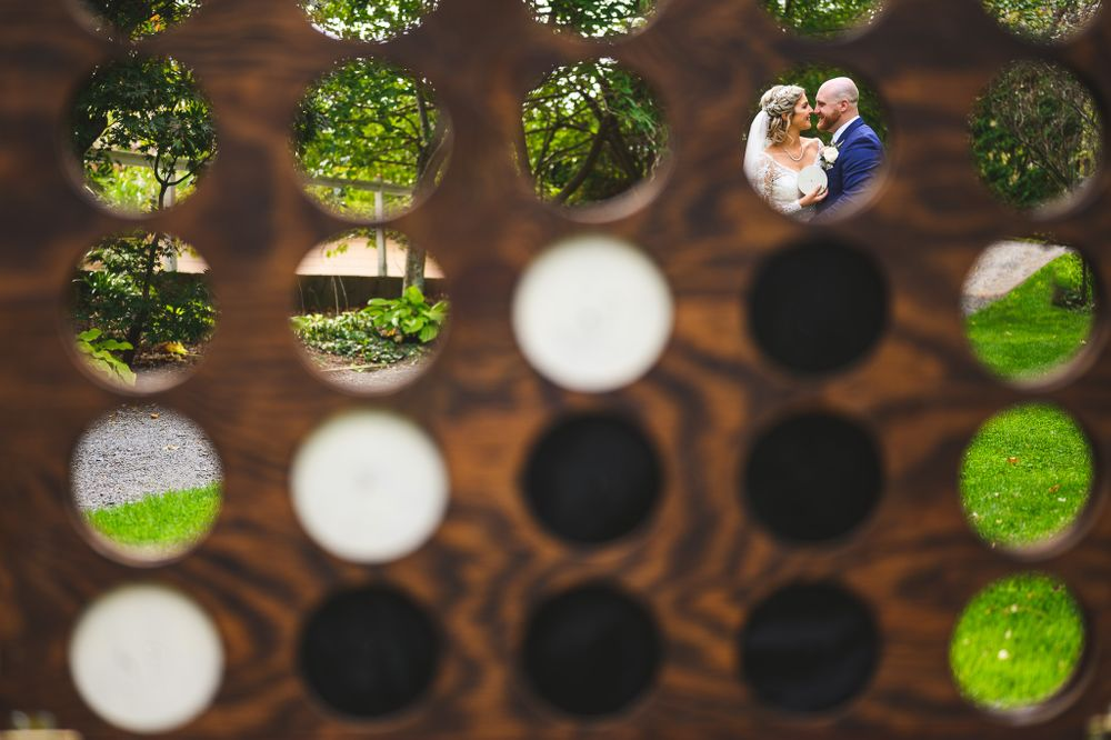 married couple about to kiss through connect 4 game at the estate at eagle lake