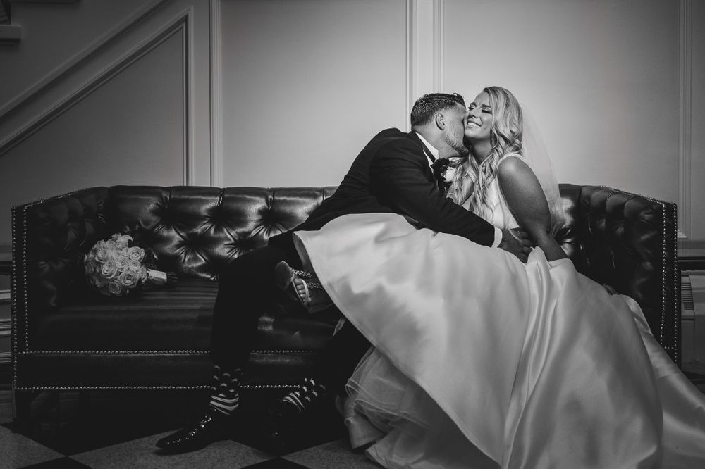 bride and groom enjoying moment on sofa at addison park
