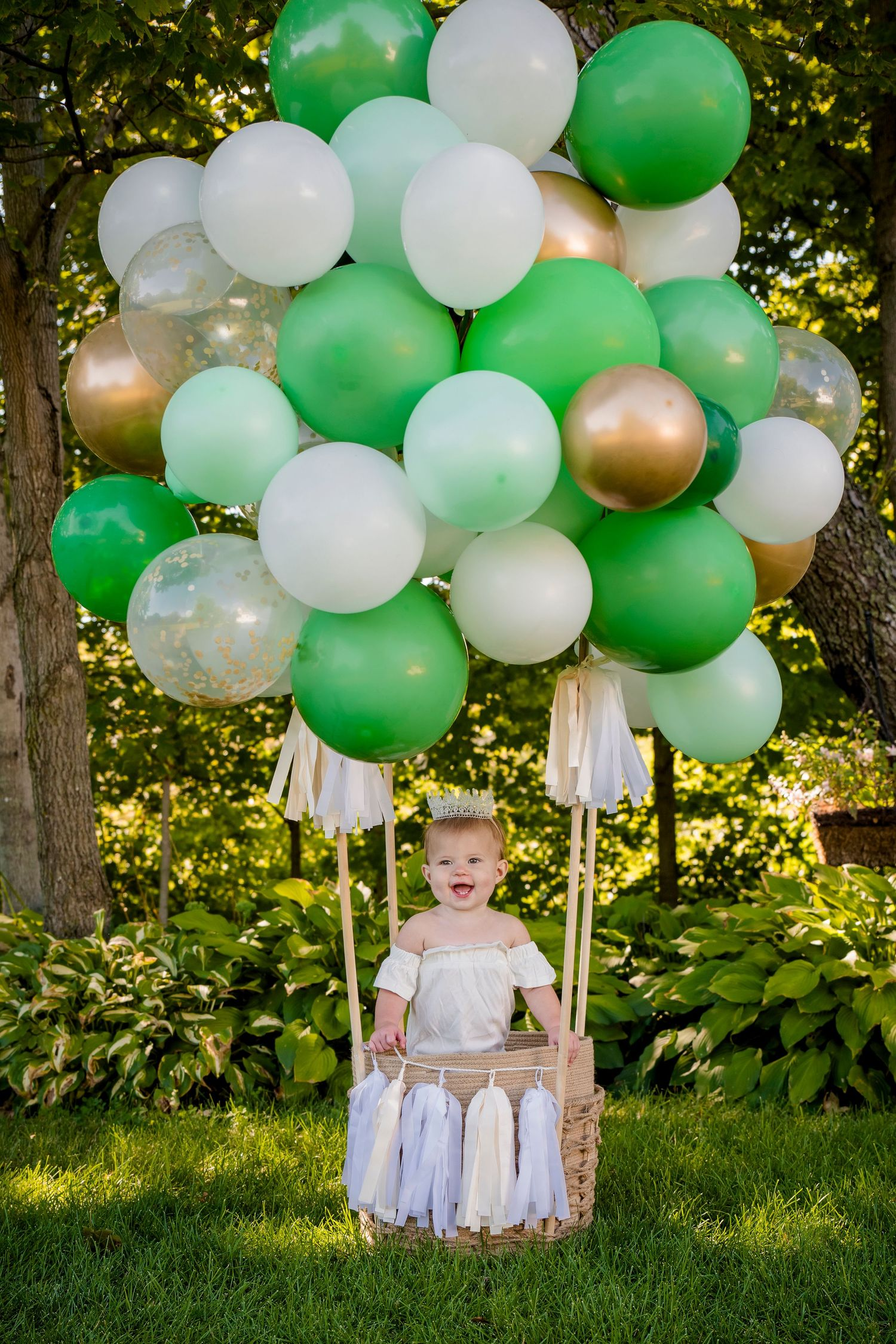 one year old girl green and gold hot air balloon