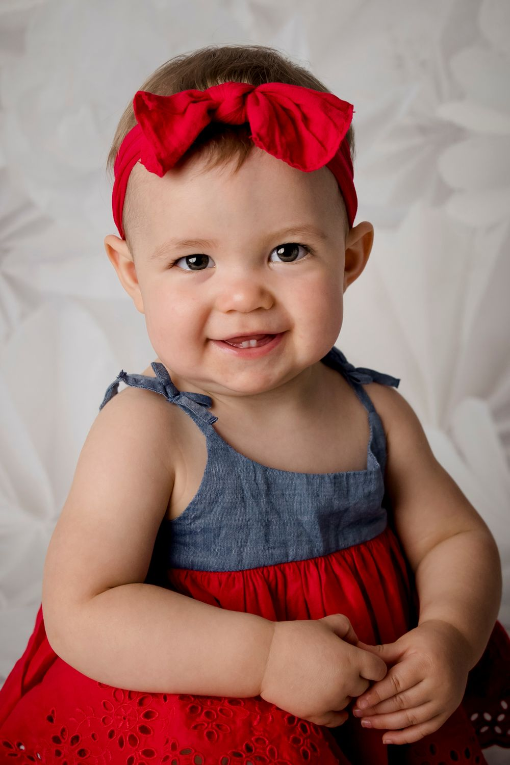 one year old girl in blue and red sundress