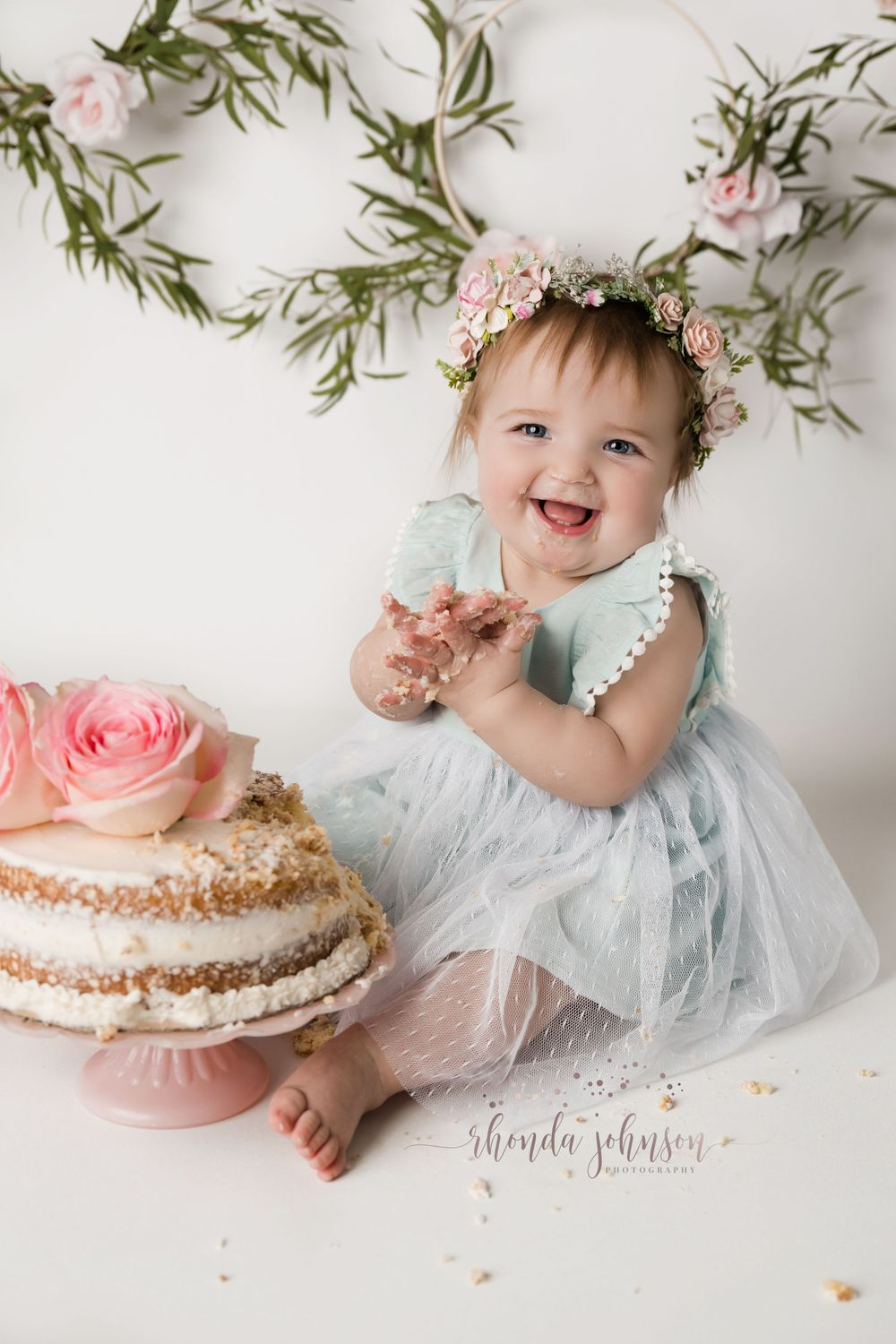 one year old girl cake smash floral hoops and floral crown
