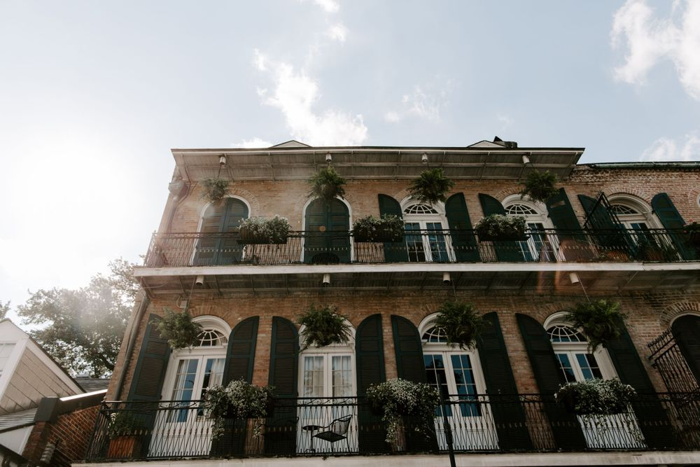Looking up view of a building in the French Quarter with a double  balcony, New Orleans Elopement