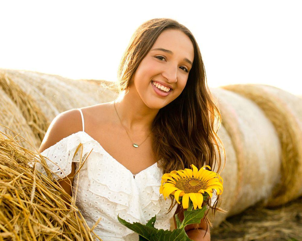 Sunflower field & hay bale senior pictures in Valley & Omaha, NE
