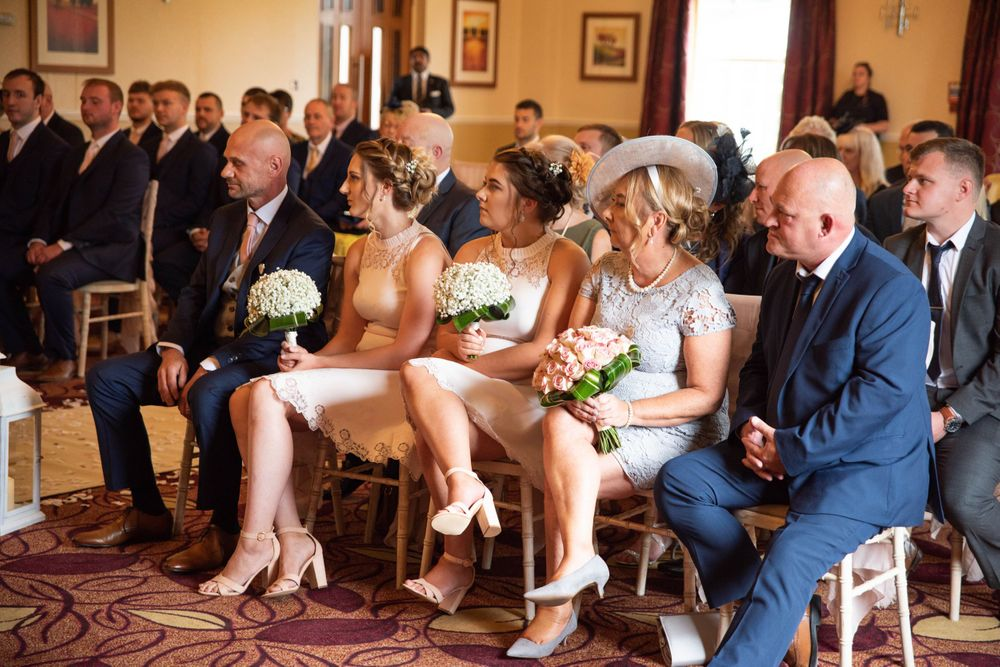 Zara Davis Wedding Photography near Stroud, Gloucestershire in the Cotswolds. Pukrup Hall guests during ceremony