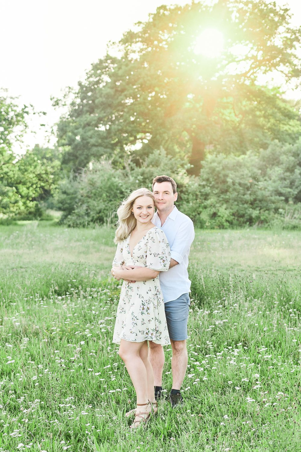 beautiful stand amongst wildflower meadow for engagement shoot at Catton Park, Norwich