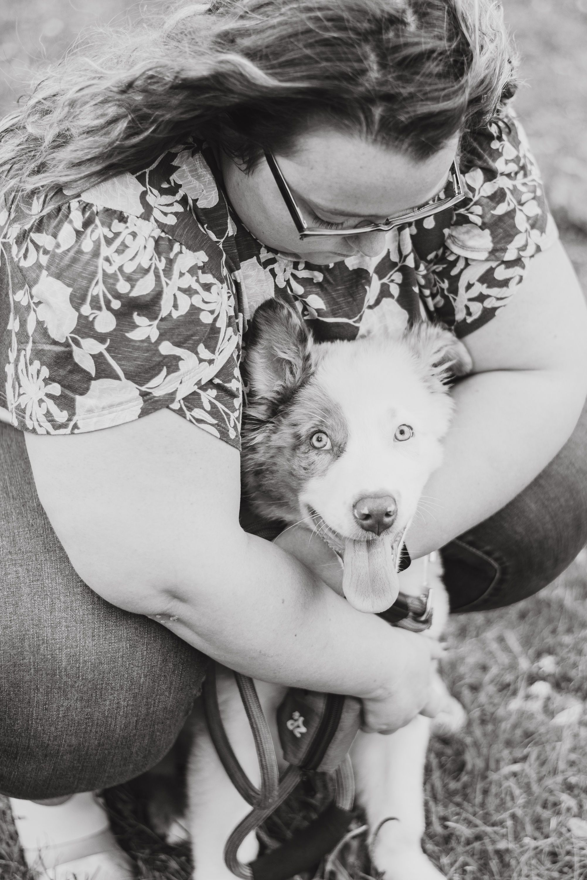 Mom and Australian shepherd puppy in black and white at Succop Nature Park in Butler Pennsylvania