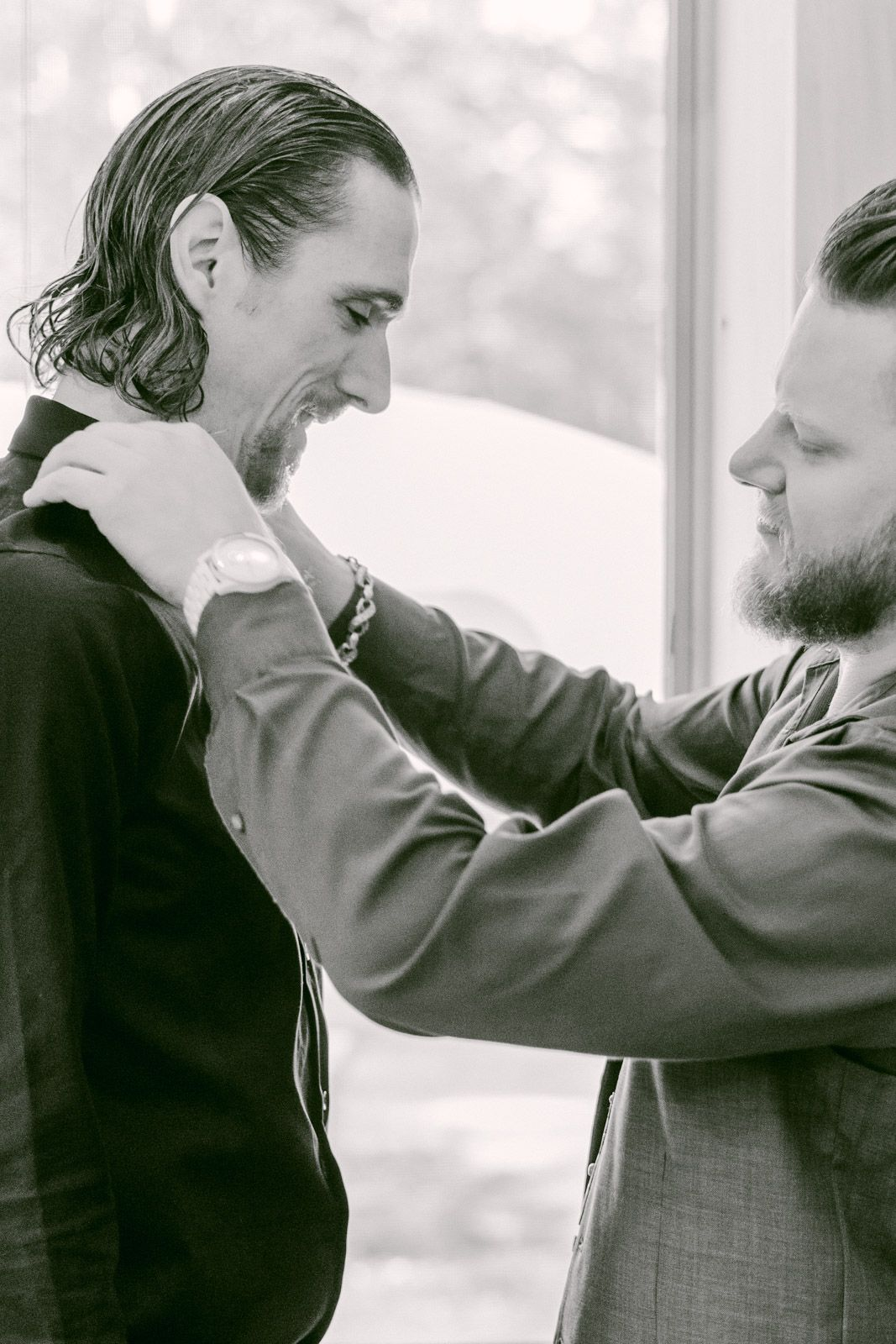 Details of Groom getting ready with friend